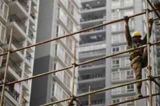 A migrant worker at a construction site in Guangzhou