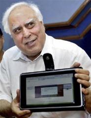 Kapil Sibal displays laptop