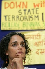 Social activist Arundhati Roy listens to a speaker during a press conference organized by People's Union for Civil Liberties, PUCL, in New Delhi, India, Thursday, May 17, 2006. The PUCL condemned the arrest of their Chhattisgarh state general secretary Binayak Sen on May 14 for alleged links with banned Maoist groups. (AP Photo/Gurinder Osan)